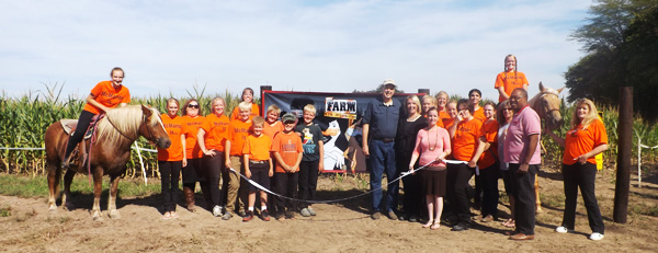 September 24th 2015 - Mike Burton, Mayor of Carlyle and Cheryl Roberts of the Carlyle Lake Chamber of Commerce, joined the Mooth family to celebrate the opening of the Corn Maze.